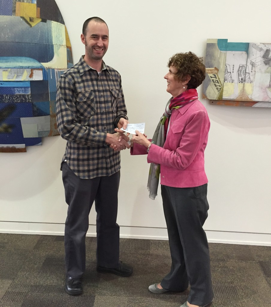 Jeff receiving his CCAI honorarium check from Sharon Rosse