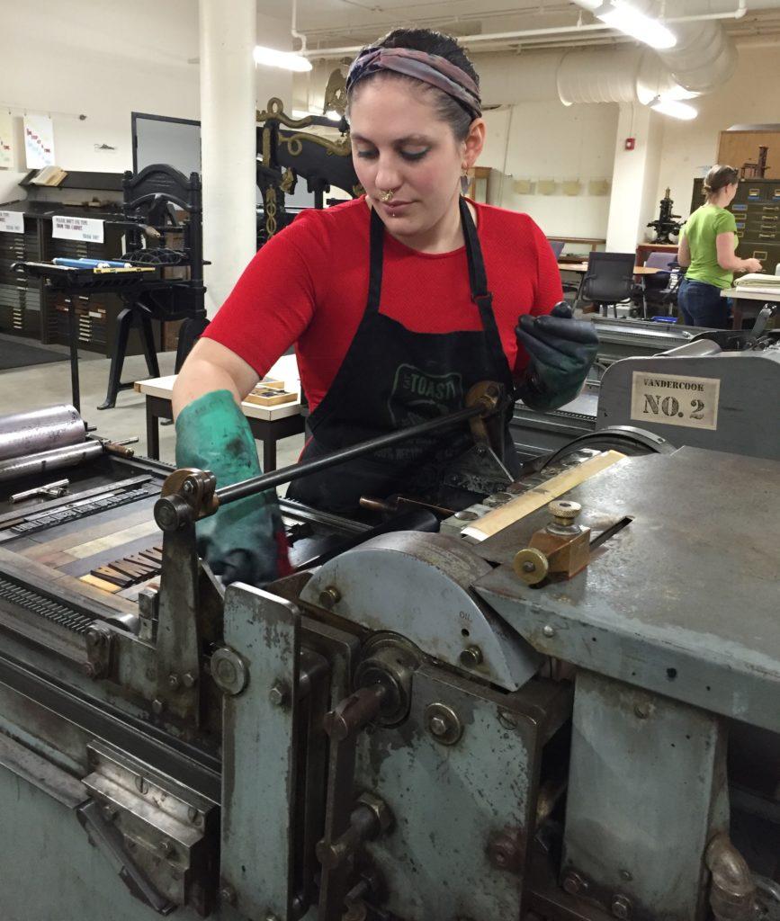 UNR student Marie Sophia Sevier Dyer working on a Vandercook press, 5/31/16