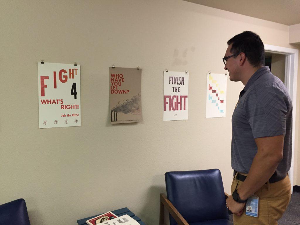 "Carson City employee Guillermo Munoz  enjoying the ""Print Project"" exhibit, 7/20/16"