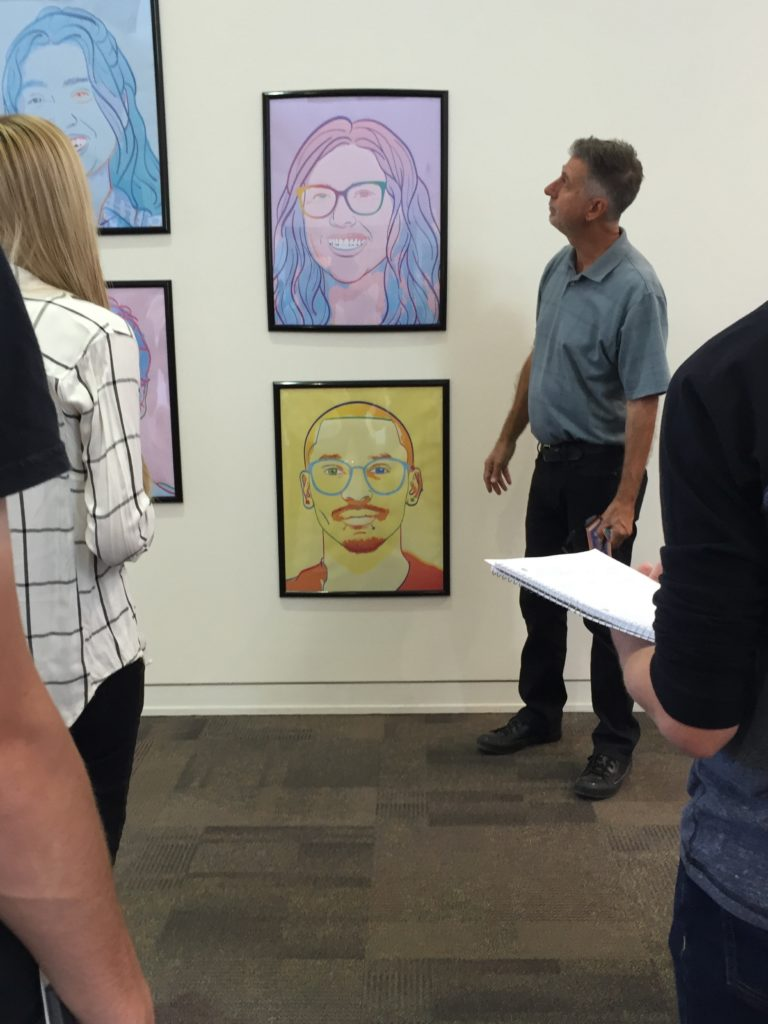 Stephen Reid discussing the art with his Visual Foundations 2 students, 9/20/16